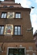 Turtingi pirkliai ištaiginkai puošė savo namų fasadus